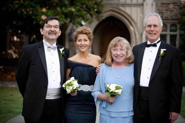Bride and groom's parents in formal wedding attire