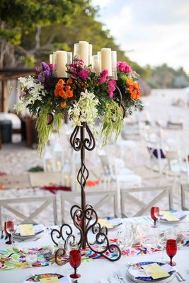 tall iron stand colorful flowers candles arrangement cascading beach wedding destination mexico