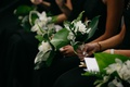 bridesmaid bouquets with tropical leaves, ferns, white flowers