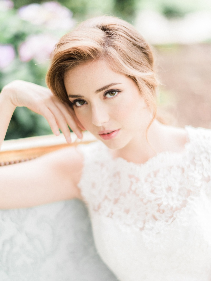 bride with natural makeup and ponytail Jinza Couture Bridal wedding dress