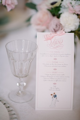 White wedding reception menu with pink bow and font