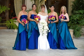 Bride with bridesmaids in two-tone gowns