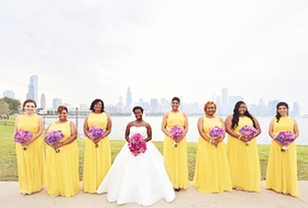 Bridesmaids in long yellow dresses, purple bouquets, with bride in strapless Pnina Tornai ball gown
