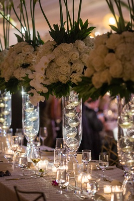 wedding reception centerpieces, florals on glass stands with glass bulbs, ivory roses, orchids,