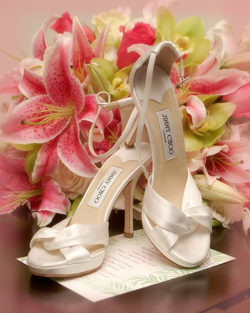 68cc4c59358 Shoes + Bags Photos - White Wedding Shoes next to Lilies - Inside ...