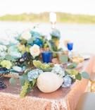 sequin tablescape with shells, candlesticks, floral arrangements