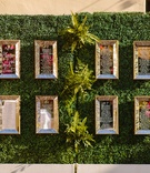 mirrored seating charts, ivy walls reception seating hedge green wall