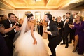 newlyweds share dance floor guests white ball gown fun reception black tuxedo pelican hill