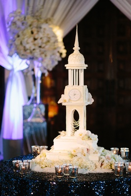 four foot tall wedding cake modeled after cathedral with fresh orchids and couple's wedding logo