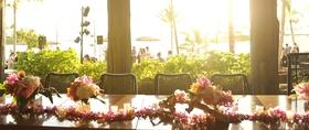 Hawaiian lei, candles, and tropical flower centerpiece