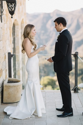 bride in strapless romona keveza wedding dress with sweetheart neckline reads letter to groom