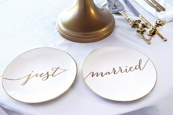 "wedding cake plates reading ""just married"" in gold"