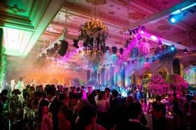 wedding reception bright lighting purple blue yellow green wedding bar live band revelery