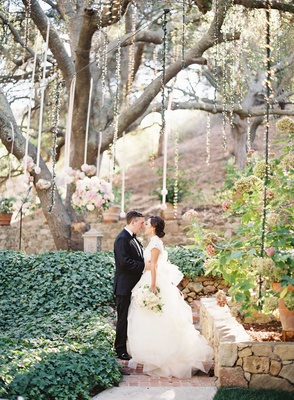 Caroline Sung and Robert Bowling wedding portrait at fairy tale outdoor wedding under tree in Malibu
