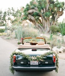 1980s rolls royce convertible getaway car with garland of greenery and succulents