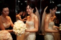 Bride in a beaded Lazaro gown and bridesmaid in an Amsale dress
