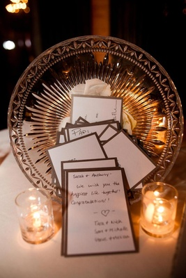 Crystal bowl holding candlelit stationery with guest notes