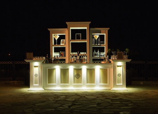 Wedding bar stocked with bottles of alcohol