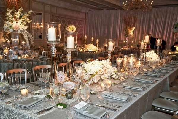 Wedding reception in Chicago with white pink flower centerpiece and candle holders