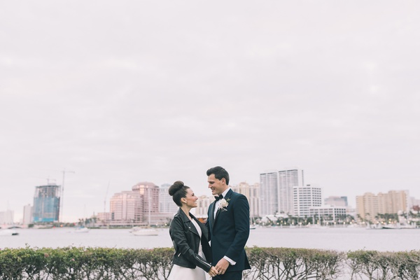bride wearing leather jacket over romona keveza gown, palm beach wedding