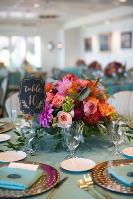 bright colored flowers centerpiece beach wedding