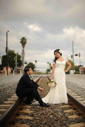Bride and groom in vintage-inspired wedding attire