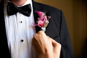 Tuxedo with bright pink flowers, twine, and ribbon