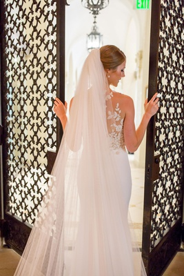 bride in pronovias atelier wedding dress and cathedral