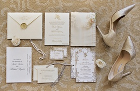 invitation suite with ivory, champagne, and gold color palette