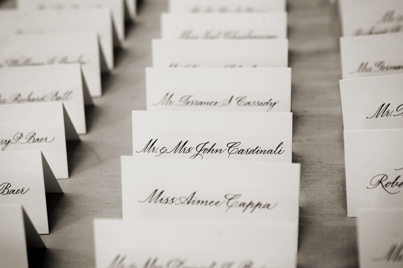 Simple seating card with black calligraphy