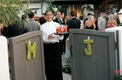 Signature cocktails awaited guests behind gate with flower initials