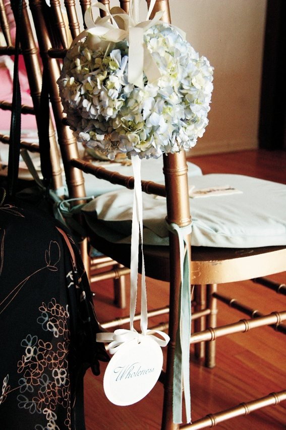 Ribbon and flower decorations on aisle chairs