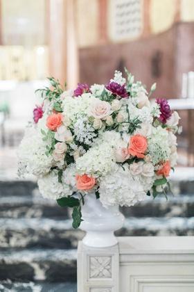 Wedding ceremony flower arrangement white urn with white hydrangea peach rose purple flower dahlia
