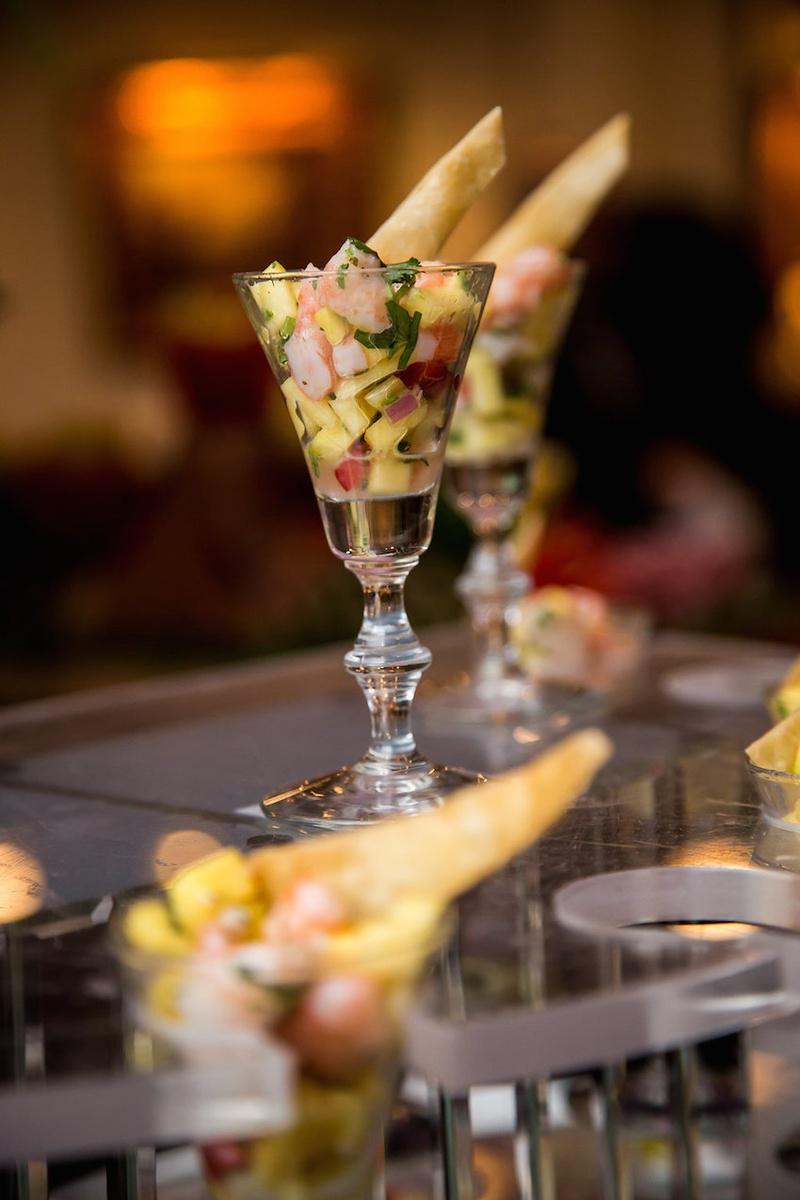 Wedding cocktail hour shrimp ceviche appetizer in elegant glasses