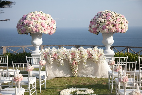 Bali wedding with white and pink flowers at ceremony