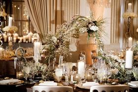 wedding reception unique modern decor white flowers greenery chain centerpiece metallic details