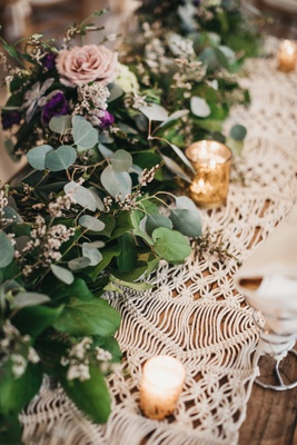 macrame runner topped with gold mercury votives and garland with eucalyptus