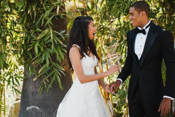 groom in custom tuxedo and textured jacket, bride in eve of milady dress