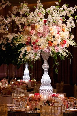 Crystal vase overflowing with roses and hydrangeas