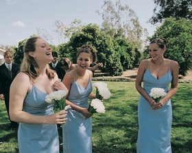 Candid shot of bridesmaids holding tulips