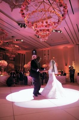 bride and groom dance on pink dance floor