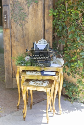 1920s nesting tables and antique typewriter for Great Gatsby themed wedding