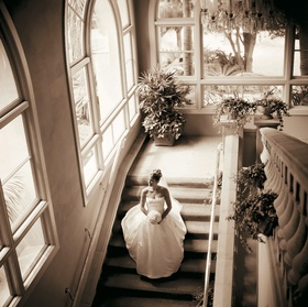 Sepia tone picture of bride walking down stairs