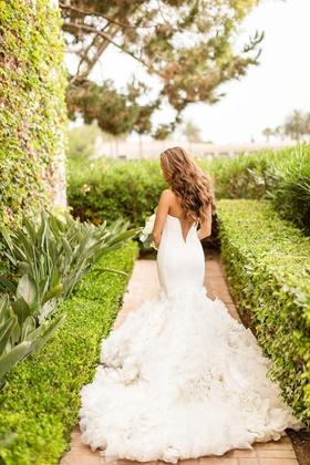 ines di santo wedding dress with ruffled mermaid skirt and v-back detail