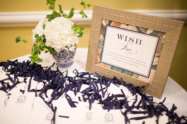 Wish tree at wedding reception tags with monogram and sign with magnolia print ginger jar