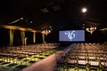 wedding anniversary party screen with video for wedding guests translucent chairs aisle