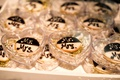 dessert table sweets table wedding reception black and white cookie with mr and mrs written on them