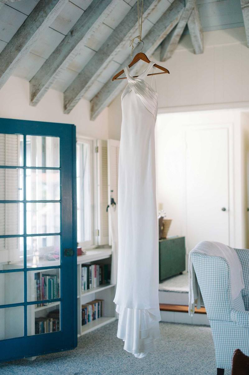 halter wedding dress hanging up suzanne neville white seaside wedding oceanside california