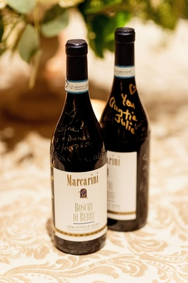 Marcarini Boschi di Berri Dolcetto d'Alba wine bottles signed by guests with gold and silver sharpie
