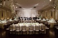 Garlands of white flowers and chandeliers over tables